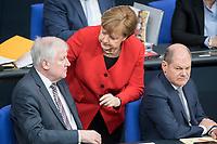 21 MAR 2019, BERLIN/GERMANY:<br /> Horst Seehofer (L), CSU, Bundesinnenminister, Angela Merkel (M), CDU, Bundeskanzlerin, und Olaf Scholz (R), SPD, Bundesfinanzminister, im Gespraech, Bundestagsdebatte zur Regierungserklaerung der Bundeskanzlerin zum Europaeischen Rat, Plenum, Deutscher Bundestag<br /> IMAGE: 20190321-01-063<br /> KEYWORDS: Gespräch
