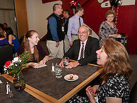 Brittney Pond with Rick Crockford (Social Studies), Sharon Pond and Mike Pond (not in photo) share a laugh during the Top Ten dinner at the Huot Center on Thursday evening.  (Karen Bobotas/for the Laconia Daily Sun)
