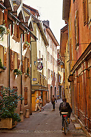 View of a narrow street, and colorful historic buildings, Old Annecy, France.