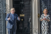 "As part of the NHS birthday celebrations, Prime Minister Boris Johnson (left in picture) and Annemarie Plas (right in Picture), founder of ""Clap For Our Carers"" appeared outside 10 Downing Street, London on Sunday, July 5, 2020, to join in the pause for the applause to salute the NHS 72nd birthday. (VXP Photo/ Vudi Xhymshiti)"