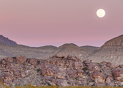 Moon and sunset, Hueco Tanks State Park & Historic Site, El Paso, Texas. USA.