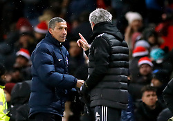Manchester United manager Jose Mourinho (right) and Brighton & Hove Albion manager Chris Hughton after the Emirates FA Cup, quarter final match at Old Trafford, Manchester.