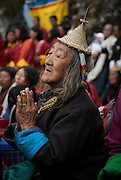 Laya woman from one of thehighest and remotes villages in Bhutran at 3700m. wearing traditional distinct dress with conical bamboo hats & spike attached by beaded band strap