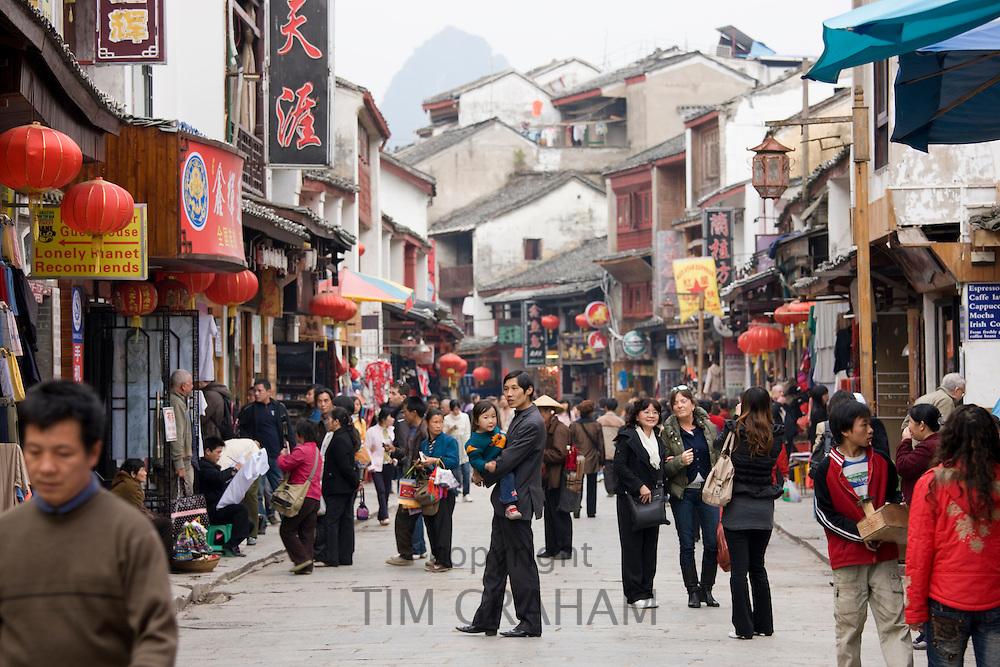 Crowded shopping street in Yangshuo, China