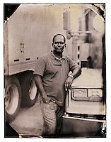 I was wandering around with my portable dark box on wheels in the backlot of the TA Truck Stop in Baldwin, FL, when I heard longhaul truck driver Ridley Singh, 56, lightly sound his truck's horn to get my attention. Showing him the camera and various chemicals used, he recalled having his photo taken using a similar process back home in Jamaica.<br /> <br /> He's been in the states since 1995 and came looking for better opportunities for his family. Both he and his wife are truck drivers for their own company - Never Seen Trucking.
