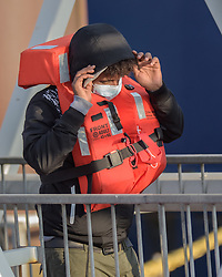 © Licensed to London News Pictures. 16/09/2021. Dover, UK.  A migrant arrives on a Border Force cutter at Dover Harbour in Kent. Migrants are continuing to attempt the crossing from France as the weather improves this week. Photo credit: Stuart Brock/LNP