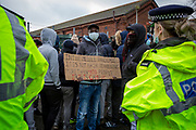 Asylum seekers currently held inside Napier Barracks staged a peaceful protest outside the entrance to the barracks with banners and signs to demonstrate about the poor conditions they are subjected to inside the holding centre on the 12th of January 2021, Folkestone Kent. Over 400 asylum seekers are being kept at Napier Barracks in unsuitable, cold accommodation, they are experiencing mental health issues as well as being vulnerable to health conditions including COVID-19.  (photo by Andy Aitchison)