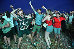 © Licensed to London News Pictures. 03/07/2018. Brighton, UK.  Penalty shoot out. England fans watch the the World Cup second round match between England and Colombia on a big screen on Brighton beach, on the south coast of England. Photo credit: Ben Cawthra/LNP