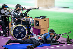 TOKYO, JAPAN - SEPTEMBER 03: Christophe Tanche of Team France and Kevin Nguyen of Team USA compete in the R6 - Mixed 50m Rifle Prone SH1 Qualification on day 11 of the Tokyo 2020 Paralympic Games at Asaka Shooting Range on September 4, 2021 in Asaka, Japan. Photo by Vid Ponikvar / Sportida