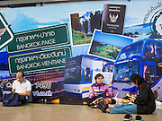 04 JANUARY 2015 - BANGKOK, THAILAND: Passengers sit on the floor of Mo Chit Bus Station in Bangkok. Mo Chit, also called the Northern Bus Station, is the largest bus station in Thailand. Buses from Mo Chit go to most places in Thailand, including the Isan region, the northern cities of Chiang Mai and Chiang Rai, and the Burmese border. Millions of Thais hit the road Sunday returning to Bangkok after the long weekend New Year holiday. Train stations and trains were packed and the state owned bus company scheduled thousands of extra buses to handle the demand.    PHOTO BY JACK KURTZ