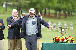 May 5, 2019 - Charlotte, North Carolina, United States of America - Max Homa puts on the winner's jacket after winning the 2019 Wells Fargo Championship at Quail Hollow Club on May 05, 2019 in Charlotte, North Carolina. (Credit Image: © Spencer Lee/ZUMA Wire)