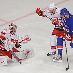 Carolina Hurricanes goalie Cam Ward (30) catches the puck and keeps it away from New York Rangers right wing Marian Gaborik (10) during first period NHL action between the Carolina Hurricanes and the New York Rangers at Madison Square Garden in New York, N.Y.