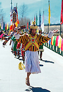 Dancers in festival procession in Thimpu, Bhutan RESERVED USE - NOT FOR DOWNLOAD -  FOR USE CONTACT TIM GRAHAM
