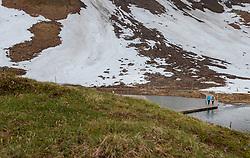 THEMENBILD - ein Pärchen überquert auf einem Steg die Fuscher Lacke. Die Grossglockner Hochalpenstrasse verbindet die beiden Bundeslaender Salzburg und Kaernten mit einer Laenge von 48 Kilometer und ist als Erlebnisstrasse vorrangig von touristischer Bedeutung, aufgenommen am 5. Juni 2017, Fusch a. d. Glocknerstrasse, Oesterreich // A couple crosses on a footbridge the Fuscher Lacke. The Grossglockner High Alpine Road connects the two provinces of Salzburg and Carinthia with a length of 48 km and is as an adventure road priority of tourist interest at Fusch a. d. Glocknerstrasse, Austria on 2017/06/05. EXPA Pictures © 2017, PhotoCredit: EXPA/ JFK