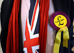 © Licensed to London News Pictures. 26/04/2012. London, UK . A member of the conference wears a Union Flag tie and UKIP rosette. The UK Independence Party (UKIP) local election campaign launch at St Stephen's Club, Central London. Photo credit : Stephen Simpson/LNP