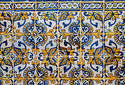 Antique floral decorated Azulejo ceramic tiles in yellow, white and blue colours on wall inside a church, Evora, Alto Alentejo, Portugal, southern Europe