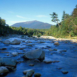 White Mountain National Forest.  View of Mt. Madison and the rocky Peabody River from NH Route 16. Northern Presidentials. Gorham, NH