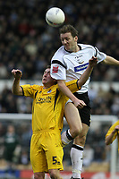 Photo: Pete Lorence.<br />Derby County v Bristol Rovers. The FA Cup. 27/01/2007.<br />Steve Howard clears the ball from Craig Hinton.