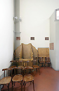 confessional placed in the corner of church Florence Italy