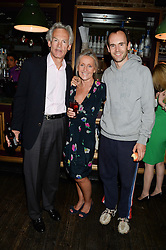 Left to right, ROD FABRICIUS, DEBBIE FABRICIUS and their son BALTHAZAR FABRICIUS at the Weigh In Party for the upcoming Boodles Boxing Ball held at Bunga Bunga, Battersea Bridge Road, London on 5th September 2013.