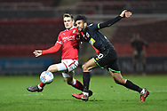 Timi Elsnik (19) of Swindon Town battles for possession with Oscar Gobern (20) of Yeovil Town during the EFL Sky Bet League 2 match between Swindon Town and Yeovil Town at the County Ground, Swindon, England on 10 April 2018. Picture by Graham Hunt.