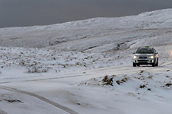 © Licensed to London News Pictures. 21/01/2021. Rhayader, Powys, Wales, UK. A motorist drives in treacherous conditions on a mountain road in the Elan Valley near Rhayader, Powys, UK. after overnight snow fell in Powys, Wales, UK. Photo credit: Graham M. Lawrence/LNP