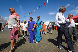 © Licensed to London News Pictures. 23/08/2019. LONDON, UK.  Devotees celebrate the birth of Lord Krishna at the Janmashtami festival at the Bhaktivedanta Manor Hare Krishna Temple in Watford, Hertfordshire.  The manor was donated to the Hare Krishna movement by ex Beatle George Harrison and annually hosts the biggest Janmashtami festival outside of India.  Photo credit: Stephen Chung/LNP