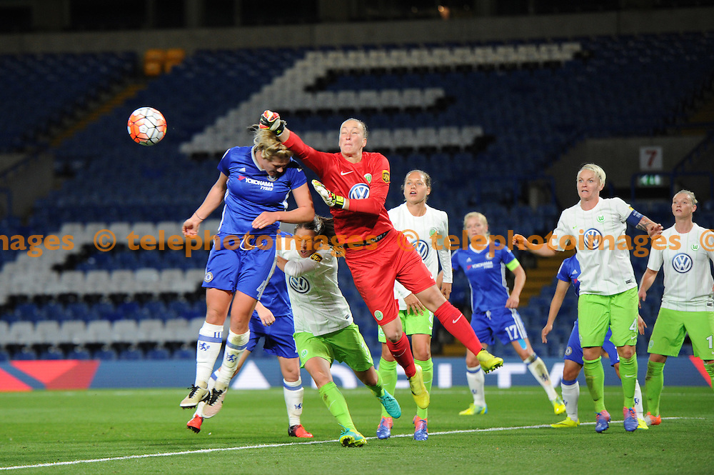 Chelseas Millie Bright and Wolfsburgs Almuth Schult in action during the UEFA Women's Champions League match between Chelsea and Wolfsburg at Stamford Bridge in London. October 5, 2016.<br />Holly  Allison / Telephoto Images<br />+44 7967 642437