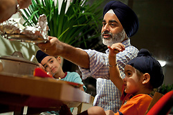 Harjinder Singh eats dinner with his family, including sons Darshan Singh, 8, and Veer Singh, 3, at their home in Battery Park, New York, N.Y., Sept. 16, 2011.