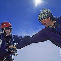 Rick Ridgeway & Alex Lowe congratulate each other after reaching the  summit of Rakekniven spire in Queen Maud Land, Antarctica.