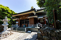 """Shinshoji is the 25thtemple on the Shikoku Pilgrimageand is one of the smallest of all the temples.  The temple is located near the tip of the Muroto Peninsular that projects out into the Pacific Ocean and overlooks the fishing harbor of Muroto. Thus local people refer to the temple as """"Tsudera"""" or Port Temple. - The temple's name means """"Temple of the Illuminating Seaport"""".  The main hall is up a long flight of steep stairs but from it there is a great view over the area. Halfway up is a Chinese-style bell tower"""