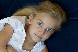 portrait of a small child with big blue eyes and blonde hair
