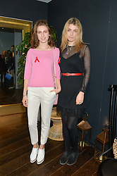 Left to right, sisters TALI LENNOX and LOLA LENNOX at the mothers2mothers World AIDS Day VIP Lunch with Next Management & THE OUTNET.COM held at Mondrian London, 19 Upper Ground, London on 1st December 2014.