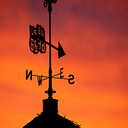 Sunset in Stroud, Oklahoma with motorcycle and Route 66 weathervane.