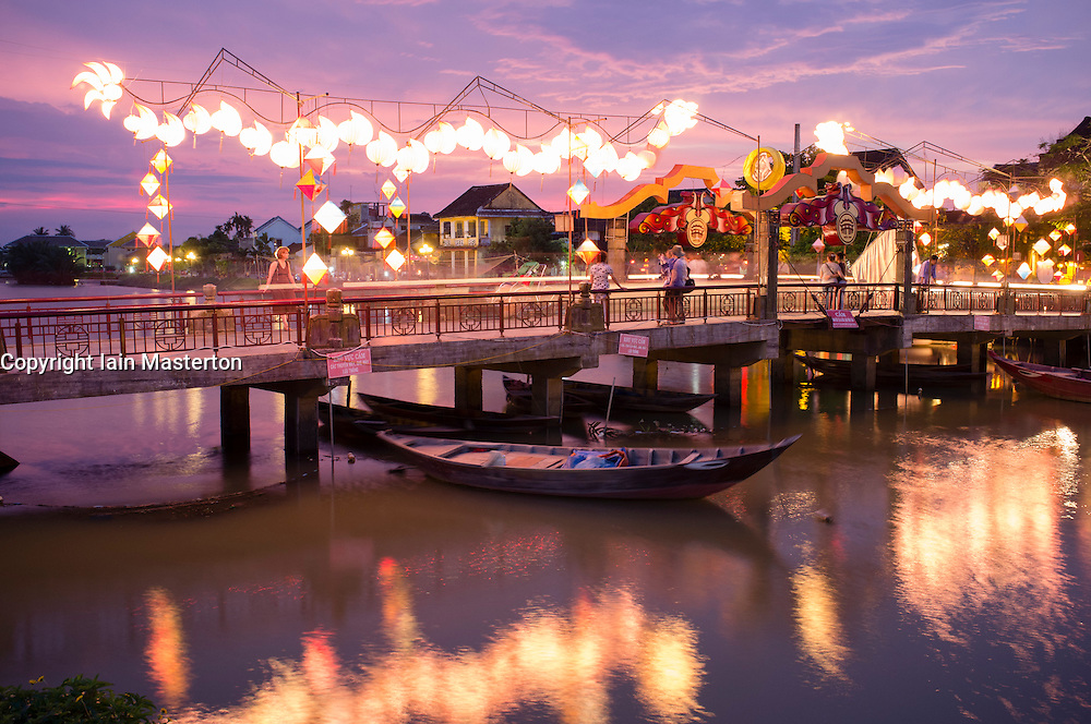Evening view of bridge over river in historic old town of Hoian a UNESCO World Heritage site in Vietnam