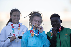BUENOS AIRES, Oct. 15, 2018  Gold medalist Barbora Malikova (C) of Czech Republic, silver medalist Marie Scheppan (L) of Germany and bronze medalist Niddy Mingilishi of Zambia pose for photos during the awarding ceremony of women's 400m of athletics event at the 2018 Summer Youth Olympic Games in Buenos Aires, Argentina, Oct. 14, 2018. (Credit Image: © Xinhua via ZUMA Wire)