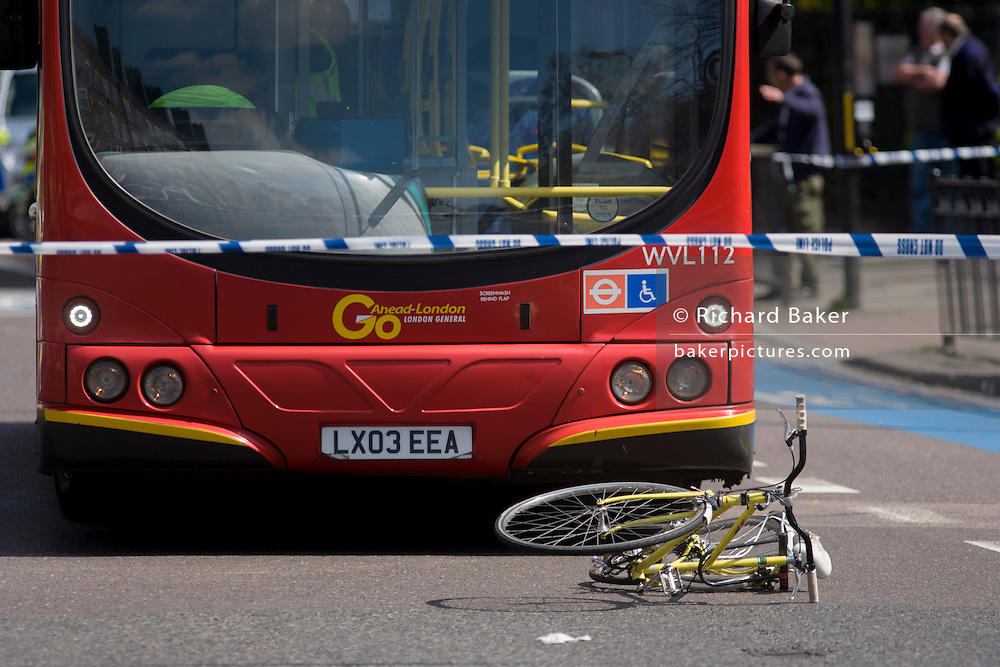 The crushed wreckage of a ladies bike lies on the surface of the A3 Kennington Park Road at the junction with A23 Kennington Road, south London. A woman in her twenties was taken to King's College Hospital with a leg injury after a crash between a bus and a cyclist this morning. Emergency services were called to Kennington Park Road at 9.30am. A London Buses statement reads: ?At around 09:30 this morning a route 333 bus, operated by London General, was involved in a collision with a cyclist ..""
