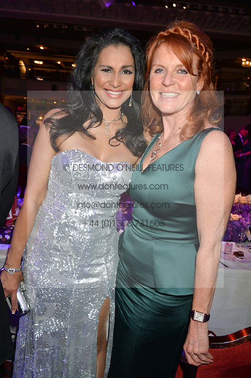 Left to right, WINNIE FORSYTH and SARAH, DUCHESS OF YORK at The Butterfly Ball in aid of Caudwell Children held at the Grosvenor House, Park Lane, London on 25th June 2015