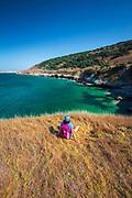 Hiker at Black Rock Point, Santa Rosa Island, Channel Islands National Park, California USA
