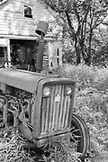 Tractor and old barn, in B&W