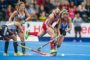 Great Britain's Alex Danson battles with the Argentina defence. Great Britain v Argentina  - Hockey Champions Trophy, Lee Valley Hockey & Tennis Centre, London, UK on 18 June 2016. Photo: Simon Parker