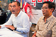 05 MAY 2010 - BANGKOK, THAILAND: L to R: Red Shirt leaders Jutaporn Prompan, Nattawut Saikuar (center) and Dr. Weng Tojirakarn during the Reds' daily afternoon news briefing in their encampment in Ratchaprasong intersection in Bangkok Wednesday. Red Shirt protesters continued their actions in Bangkok Wednesday. The Red Shirts conditionally accepted the offer of Thai Prime Minister Abhisit Vejjajiva to dissolve parliament, investigate alleged human rights violations following the violence of April 10 and call for new elections in November of this year, 18 months earlier than they are currently scheduled. They are withholding final acceptance of the so called Road Map until the Prime Minister releases more specifics on the arrangement and announces the date for the dissolution of parliament. Proposals to amend the constitution are also a sticking point. The Red Shirts want the 1997 constitution reinstated, the government and other anti-Red Shirt groups want to keep the current constitution, enacted in 2007. The Red Shirts, who started their protest on March 13, continue to call for Thai Prime Minister Abhisit Vejjajiva to step down and dissolve parliament immediately and demand the return of ousted Prime Minister Thaksin Shinawatra.   PHOTO BY JACK KURTZ