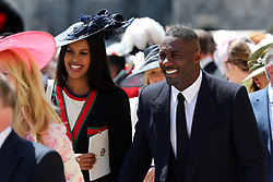Idris Elba leaves St George's Chapel at Windsor Castle after the wedding of Meghan Markle and Prince Harry.