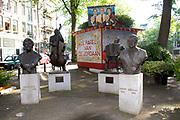 Statue of Johnny Jordaan and Tante Leen on the Johnny Jordaanplein at the Elandsgracht in the Jordaan district<br /> <br /> Johnny Jordaan was the pseudonym for Johannes Hendricus van Musscher (7 February 1924 – 8 January 1989) a Dutch folk singer. He was well known for his songs about the city of Amsterdam, especially the Jordaan district.<br /> <br /> Johnny Jordaan (echte naam Johannes Hendricus van Musscher) (Amsterdam, 7 februari 1924 – aldaar, 8 januari 1989) was een Nederlands zanger en vertolker van het levenslied. Hij is bekend geworden door zijn liederen over Amsterdam en in het bijzonder over de Amsterdamse Jordaan.