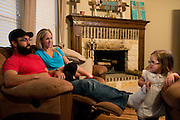 Johny Hendricks and his wife Christina play with their two-year-old daughter, Adli, at their home in Midlothian, Texas on February 27, 2014.