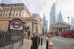 © Licensed to London News Pictures. <br /> London, UK. 24/03/2021. Members of the public are seen walking through Bank Station, central London one year after the first coronavirus lockdown was announced. <br /> Photo credit: Marcin Nowak/LNP