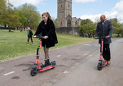 © Licensed to London News Pictures; 04/05/2021; Bristol, UK. ANGELA RAYNER, Deputy Leader of the Labour Party, tries out a Voi rental scooter with current Mayor of Bristol MARVIN REES on a visit to Bristol during the local and regional elections campaign, supporting Labour Mayoral candidate Marvin Rees who is the current elected Mayor of Bristol and other Labour candidates for the city council, police and crime commissioner, and West of England Combined Authority Mayor. Photo credit: Simon Chapman/LNP.