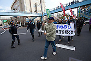 Riot police line a left-wing march against the exploitation of farmers during the construction of Narita Airport. Tokyo, Japan. Sunday March 23rd 2014. The main organiser of the protest was The Farmers' League Against Narita Airport. Around 1,000 activists from this league and other unions took part.