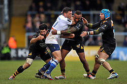 Remi Grosso of Castres Olympique is tackled - Photo mandatory by-line: Patrick Khachfe/JMP - Mobile: 07966 386802 14/12/2014 - SPORT - RUGBY UNION - High Wycombe - Adams Park - Wasps v Castres Olympique - European Rugby Champions Cup