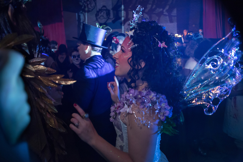 A woman costumed as a fairy.